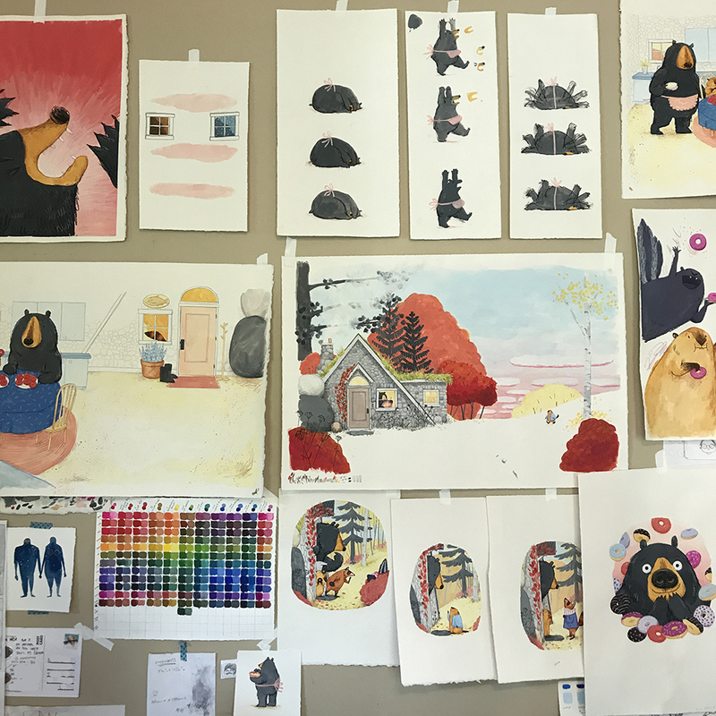 The wall of my studio while completing final art for Dozens of Doughnuts. The art was made using gouache, colored pencil, and watercolor crayons on paper.
