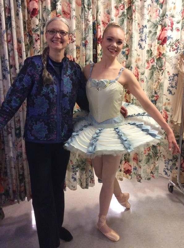 I am with my daughter, a professional ballet dancer, in her tutu just before a performance - she is the inspiration for this book!